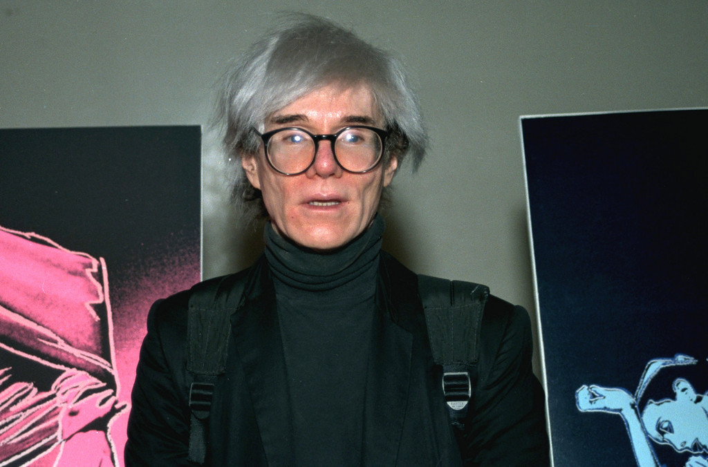 . Pop artist Andy Warhol is shown in this 1987 file photo. One of his signature silver wigs brought $10,800 when put up on the block at Christies Auction House in New York, Thursday, June 22, 2006. The hairpiece was part of an auction of celebrity memorabilia. (AP Photo/File)