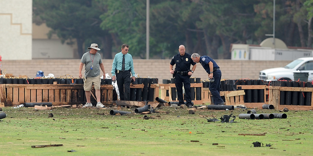 . Investigators survey the scene after a fireworks show accident injured 28 people at Rancho Santa Susana Community Park in Simi Valley, CA July 5, 2013.     (Andy Holzman/Los Angeles Daily News)