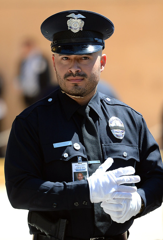 . LAPD officer Richard Medina was partners with Roberto Sanchez when he was killed in a hit-and-run crash involving a SUV driver in Harbor City, CA.  A funeral was held Wednesday for Sanchez at the Cathedral of Our Lady of the Angels in Los Angeles, CA May 14, 2014.  Sanchez was .(Andy Holzman/LA Daily News)