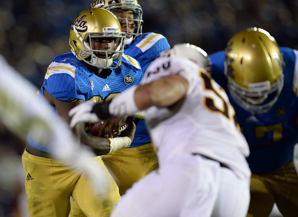 . UCLA�s Myles Jack #30 runs up the middle during their game against Arizona State at the Rose Bowl Saturday November 23, 2013. Arizona State beat UCLA 38-33. (Photos by Hans Gutknecht/Los Angeles Daily News)