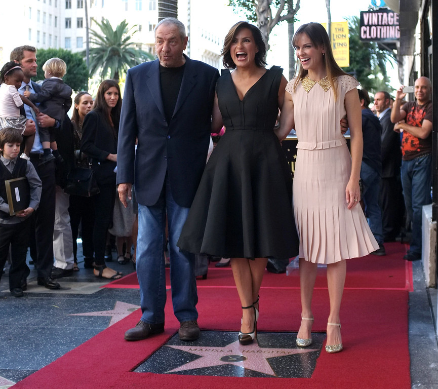 . Actresses Mariska Hargitay poses with actress Hillary Swank (R) and producer Dick Wolf (L) during a ceremony honoring Hargitay with a star on the Hollywood Walk of Fame on November 8, 2013 in Hollywood, California.        (JOE KLAMAR/AFP/Getty Images)