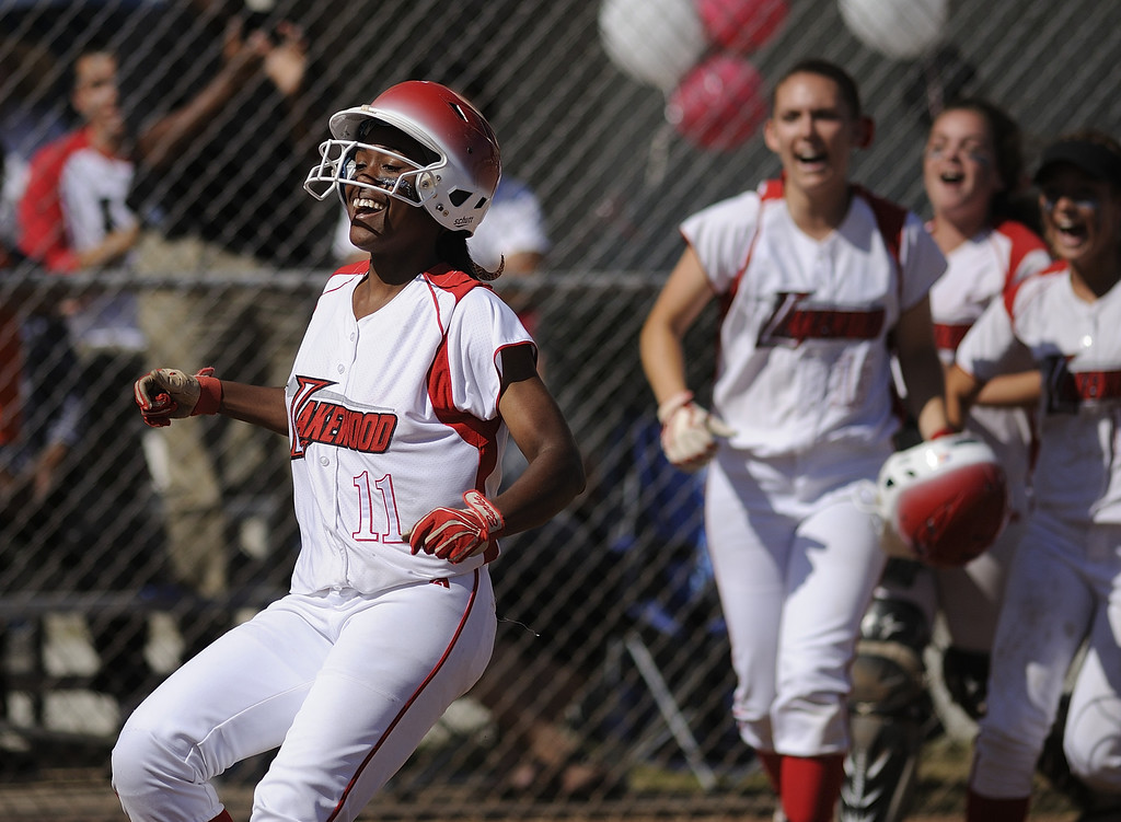 . LONG BEACH, CALIF. USA -- Lakewood\'s Tyler Burke (11) celebrates her two-run homer in the second inning against WIlson in Lakewood, Calif., on May 2, 2013. Burke\'s home run was the winning run in their 11-1 victory.  Photo by Jeff Gritchen / Los Angeles Newspaper Group