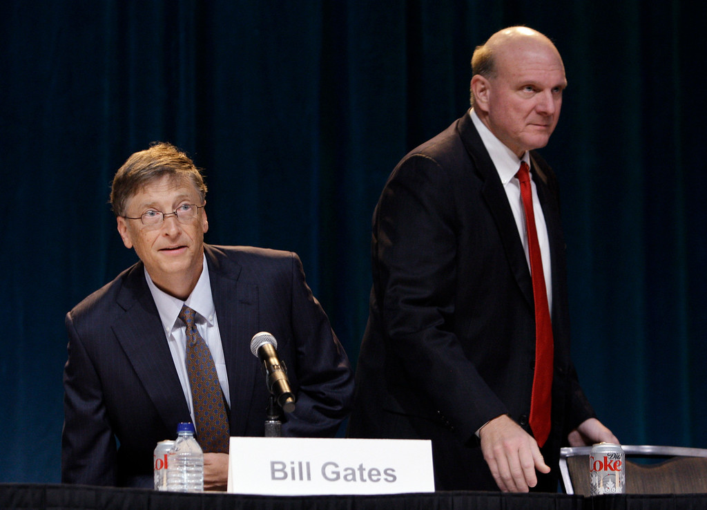 . Chairman Bill Gates CEO, left, and Steve Ballmer take their seats to begin the annual Microsoft shareholders meeting, Thursday, Nov. 19, 2009, in Bellevue, Wash. (AP Photo/Elaine Thompson)