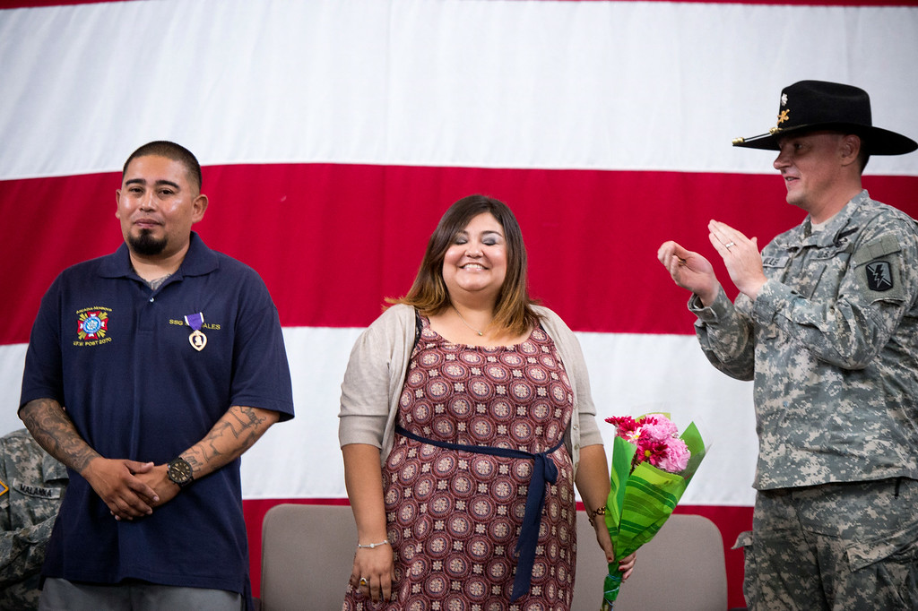 . After receiving his Purple Heart Sgt. Luis Bardales\' wife Rebecca is honored with flowers at the Army National Guard in Azusa Saturday, July 12, 2014. Bardales was wounded by a roadside IED in Baghdad, Iraq and saved gunner Gabriel Herrera by pulling him out of their Humvee before another IED explosion. (Photo by Sarah Reingewirtz/Pasadena Star-News)