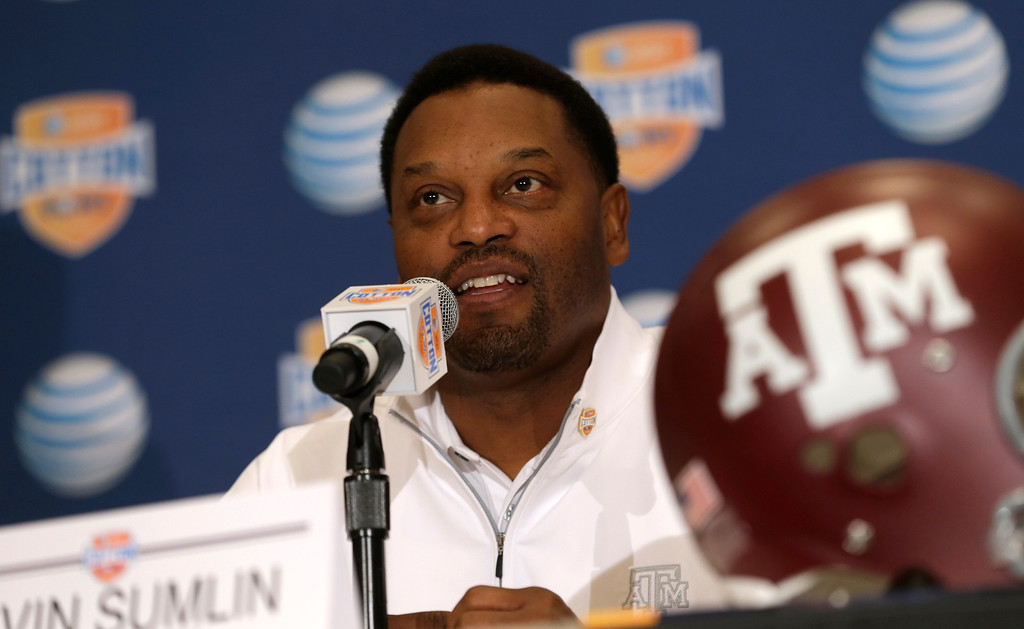 . Texas A&M head coach Kevin Sumlin answers a question during a news conference leading up to the Cotton Bowl NCAA college football game Wednesday, Jan. 2, 2013, in Irving, Texas. Before Sumlin became a successful head coach, he was on Oklahoma head coach Bob Stoops  Stoops\' staff. Before that, they were both assistant coaches recruiting the same area. Now Sumlin takes his Texas A&M team against Stoops\' Sooners in a Jan. 4th Cotton Bowl matchup of former Big 12 rivals that are both 10-2 (AP Photo/LM Otero)