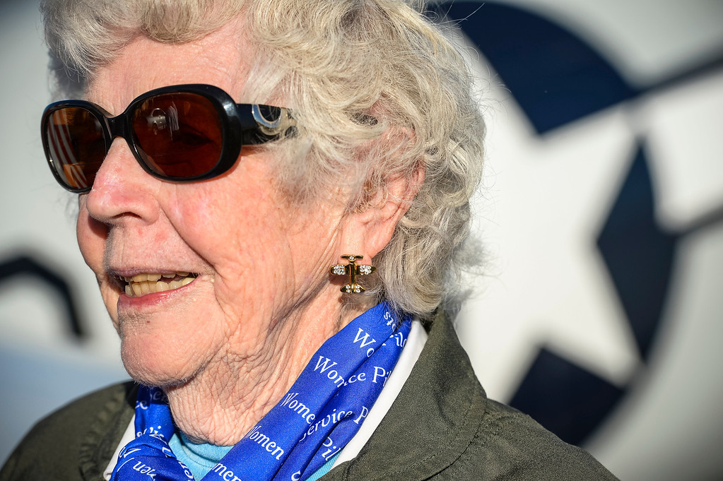 . Flora Belle Perce, 89, of Lancaster, CA sports the correct earrings as she prepares to board a vintage AT-6 airplane at Van Nuys airport Tuesday, December 30, 2013.  The Condor Squadron at the Van Nuys airport hosted the former WASP pilots who are in town to represent WASPS on a tournament of Roses float.  (Photo by David Crane/Los Angeles Daily News)