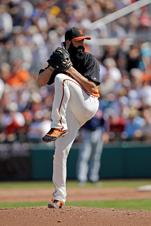 . San Francisco Giants relief pitcher Brian Wilson throws to the Cleveland Indians during the fifth inning of a spring training baseball game Wednesday, March 14, 2012 in Scottsdale, Ariz. (AP Photo/Marcio Jose Sanchez)