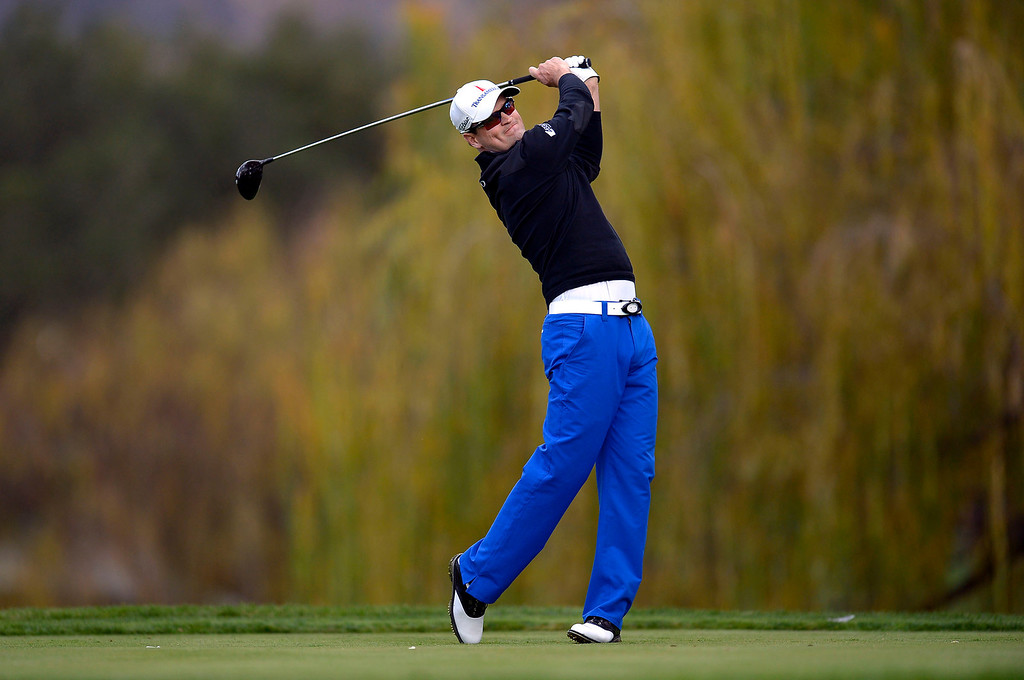 . Zach Johnson hits a shot off the fifth tee during the second round of the Northwestern Mutual World Challenge golf tournament at Sherwood Country Club, Friday, December 6, 2013, in Thousand Oaks, Calif. (Andy Holzman/Los Angeles Daily News)