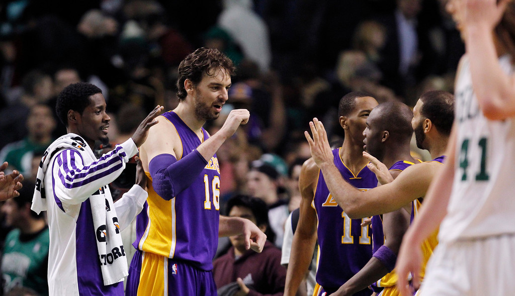 . Los Angeles Lakers center Pau Gasol (16) celebrates with teammates after defeating the Boston Celtics 107-104 in an NBA basketball game in Boston, Friday, Jan. 17, 2014. Gasol had 24 points and 13 rebounds in the win. (AP Photo/Charles Krupa)