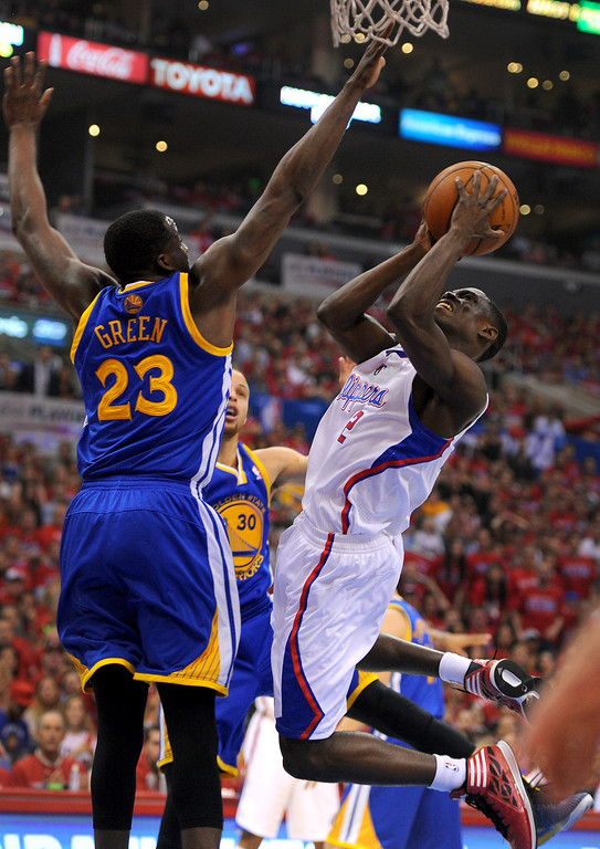 . The Clippers\' Darren Collison shoots against the Warriors\' Draymond Green in game seven of the Western Conference playoffs, Saturday, May 3, 2014, at Staples Center. (Photo by Michael Owen Baker/L.A. Daily News)