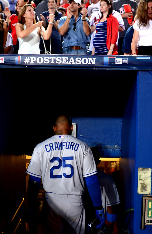 . After striking out for the final out of game 2 Los Angeles Dodgers\' Carl Crawford leaves the dugout Thursday, October 4, 2013 at Turner Field in Atlanta, Georgia. Braves defeated Dodgers 4-3. (Photo by Sarah Reingewirtz/Pasadena Star- News)
