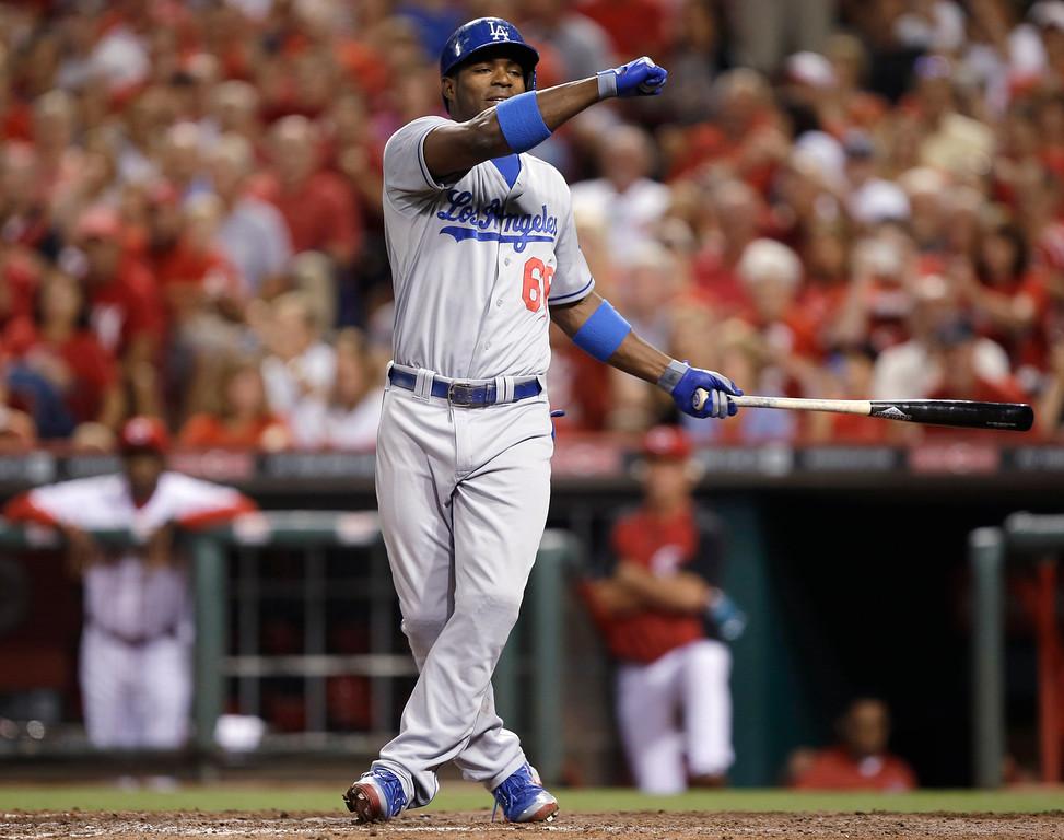 . Los Angeles Dodgers\' Yasiel Puig strikes out against Cincinnati Reds relief pitcher Aroldis Chapman in the ninth inning of a baseball game, Friday, Sept. 6, 2013, in Cincinnati. Cincinnati won 3-2. (AP Photo/Al Behrman)