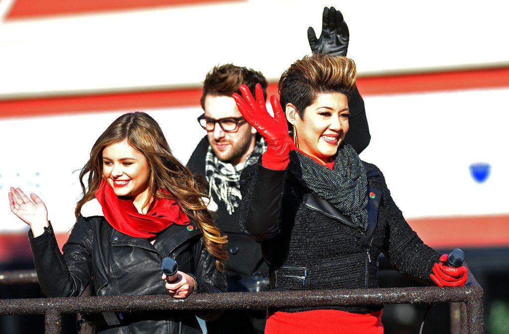 ". ""The Voice\"" participants Jacquie Lee (Season 5), Will Champlain (Season 5) and winner Tessanne Chin (l-r) ride atop The Voice float during the 2014 Rose Parade in Pasadena, CA January 1, 2014.(Keith Durflinger/San Gabriel Valley Tribune)"