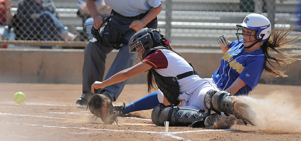 . 05-16-2013-( Daily Breeze Staff Photo by Sean Hiller) Wilson vs. El Toro in the opening round of the CIF-SS D2 playoffs Thursday at Joe Rodgers Field in Long Beach. El Toro\'s Shannon Thornton is safe against Wilson\'s Alleah Laxamana.