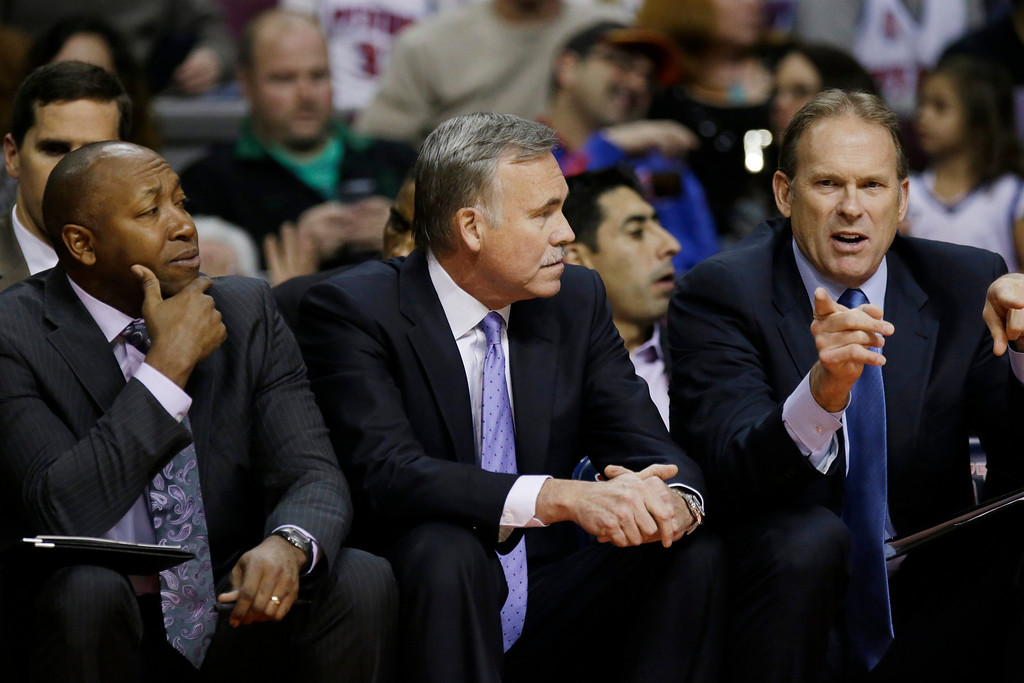 . From left, Los Angeles Lakers assistant coach Johnny Davis, head coach Mike D\'Antoni and assistant Kurt Rambis are seen on the bench during the first quarter of an NBA basketball game against the Detroit Pistons at the Palace in Auburn Hills, Mich., Friday, Nov. 29, 2013. (AP Photo/Carlos Osorio)