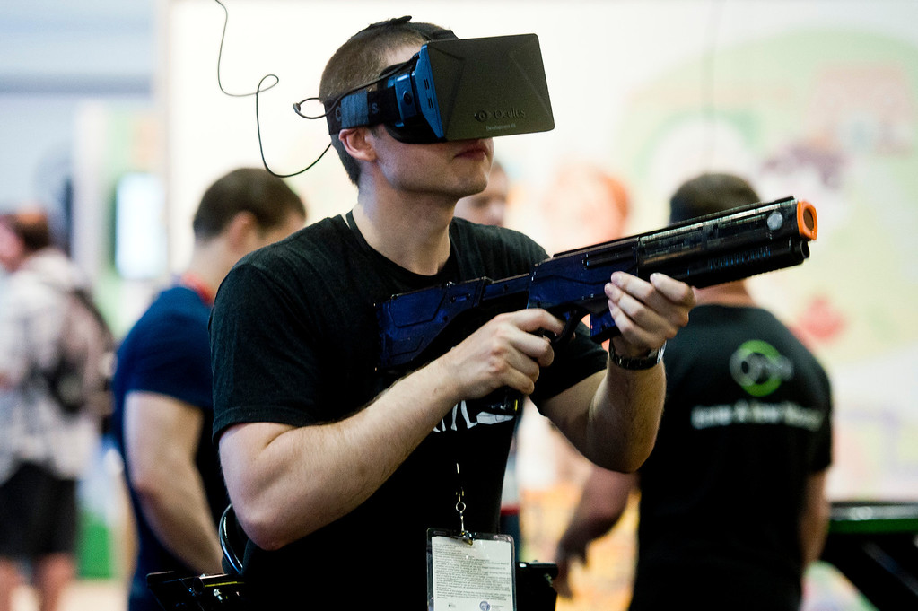 . A gamer demonstrates on the Virtuix Omni virtual reality treadmill at the Electronic Entertainment Expo in Los Angeles on Tuesday, June 10, 2014. (Photo by Watchara Phomicinda)