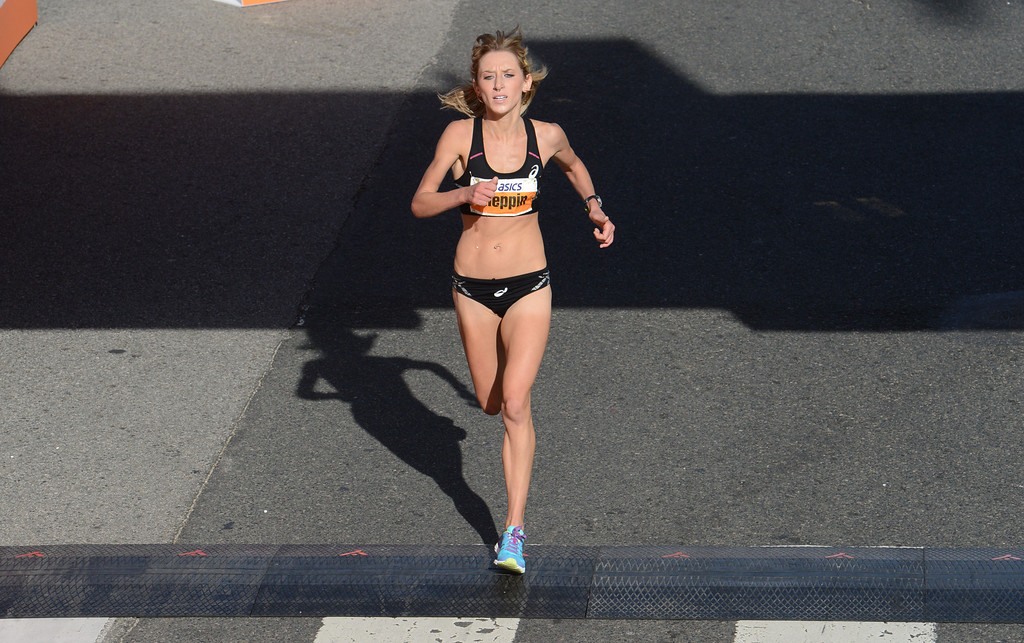 . 2014 ASICS LA Marathon women\'s 3rd place winner Lauren Kleppin of USA,  crosses the finish line in Santa Monica Calif, with a time of 2: 28:48.   Sunday, March 9,  2014.   (Photo by Stephen Carr / Daily Breeze)