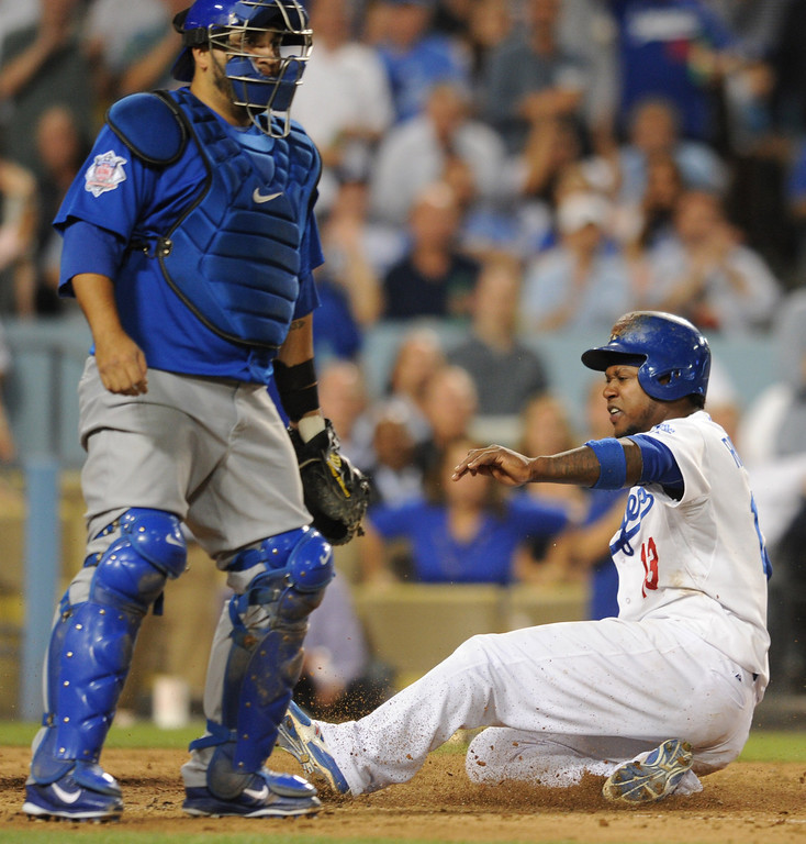 . Dodgers Hanley Ramirez scores after being driven in by Juan Uribe in the 6th inning. The Cubs were in town to play the Dodgers. Los Angeles, CA. 8/24/2013(John McCoy/LA Daily News)