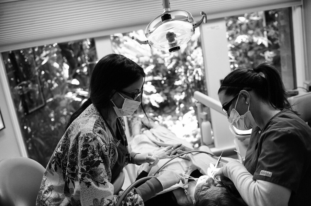 . Dentist Mary Chess-Abelson, right, works on what is left of Dorothy\'s teeth with her assistant Ileana Rodriguez in her South Pasadena office.