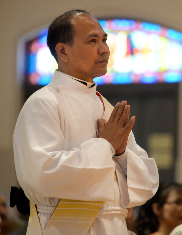 . Bishop Gerald Barnes of the Diocese of San Bernardino, ordains Kiên Trung Ki�u to the Priesthood at Our Lady of the Rosary Cathedral in San Bernardino, Friday, May 30, 2014. Kiếu was joined by clergy, friends and family during the ordination mass. (Photos by John Valenzuela/ The Sun)