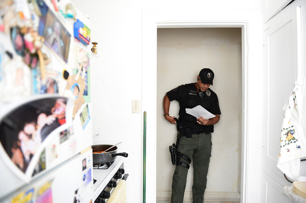. Los Angeles County Special Enforcement Probation officer Angel Gonzalez conducts a sex offender compliance check Thursday, April 25, 2013 in Los Angeles. The county has 30 armed probation officers and is seeking more armed officers to deal with realignment, the release of low-level inmates from state to county supervision. (SGVN/Staff Photo by Sarah Reingewirtz)
