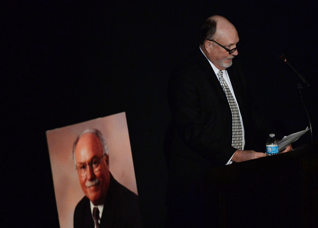 . Mark Tennant speaks about his brother during a celebration of life service for former Pasadena Fire dept. Capt. and California State fire marshall, John Tennant at the Pasadena Civic Auditorium in Pasadena, Calif., on Wednesday, Feb. 5, 2014. (Keith Birmingham Pasadena Star-News)
