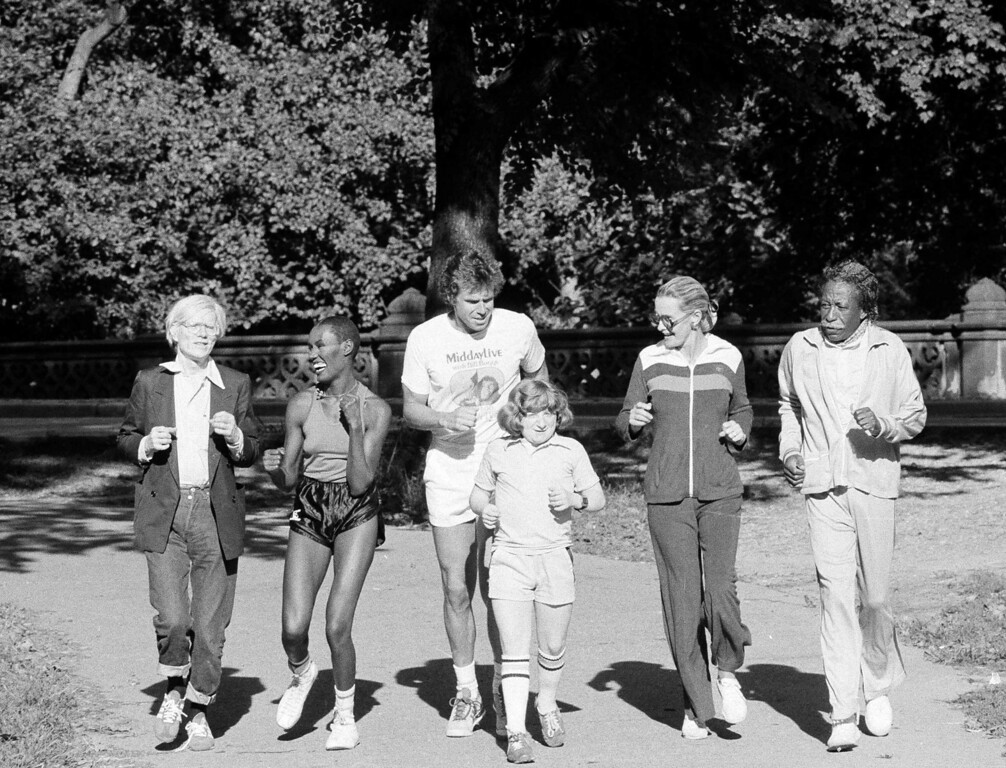 . From left, underground artist Andy Warhol, singer Grace Jones, talk show host Bill Boggs, child actor Mason Reese, actress Dina Merrill, and photographer Gordon Parks jog through New York\'s Central Park, Sept. 13, 1978, to promote an upcoming charity run later in September at Jones Beach State Park.  The run will benefit the Juvenile Diabetes Foundation. (AP Photo/Ray Howard)