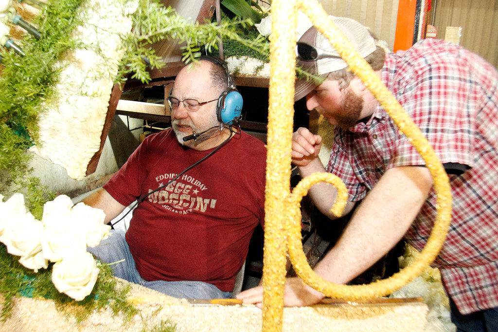 """. Jon Olson, a cpp professor and Claremont resident, test the mechanics on Michigan State\'s 2013 Tournament of Roses Parade Float, at the Artistic Entertainment Services in Azusa, CA., Tuesday, December 31, 2013. Jon Olson a \""""float operator\"""" has been driving Rose Parade floats for years, this year he has been chosen to drive the Michigan State float. (Photo by James Carbone for the Daily Bulletin)"""