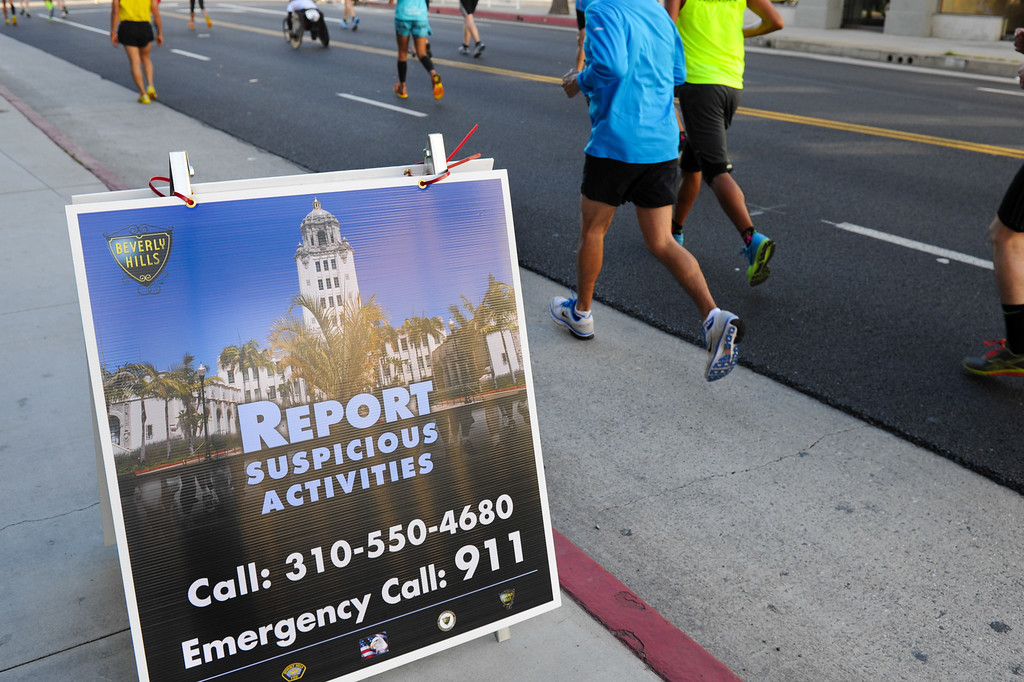 . A sign on Santa Monica Boulevard in Beverly Hills reminds people to be vigilant during the Los Angeles Marathon, Sunday, March 9, 2014. (Photo by Michael Owen Baker/L.A. Daily News)