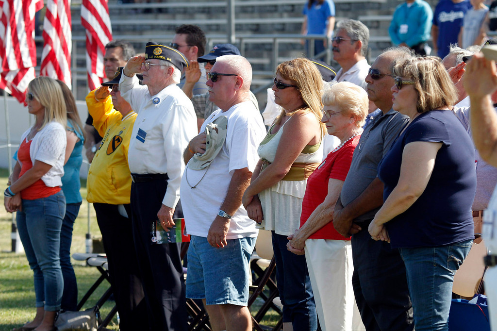 """. Guests stand and salute during the Last Bugle Call, during the Vietnam Veterans Memorial \""""The Wall That Heals\"""" Closing Ceremony at La Habra High School, in La Habra, Sunday, July 14, 2013. (SGVN/Correspondent Photo by James Carbone)"""