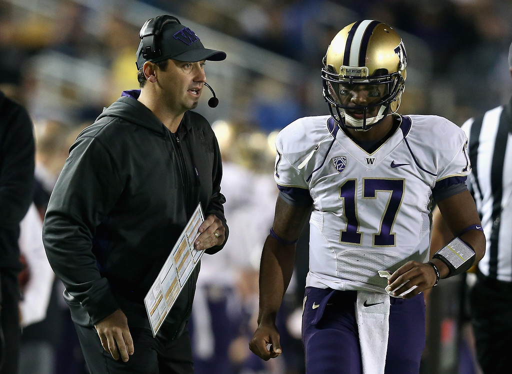 . Head coach Steve Sarkisian of the Washington Huskies talks to quarterback Keith Price #17 during their game against the California Golden Bears at California Memorial Stadium on November 2, 2012 in Berkeley, California.  (Photo by Ezra Shaw/Getty Images)