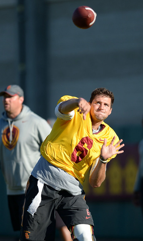 . USC quarterback Cody Kessler throws a pass during practice August 27, 2014 on USC\'s Howard Jones Field.(Andy Holzman/Daily News Staff Photographer)