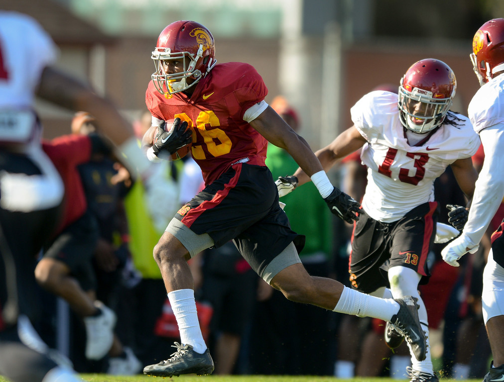 . USC RB James Toland gets through a hole at practice, Thursday, March 27, 2014, at USC. (Photo by Michael Owen Baker/L.A. Daily News)