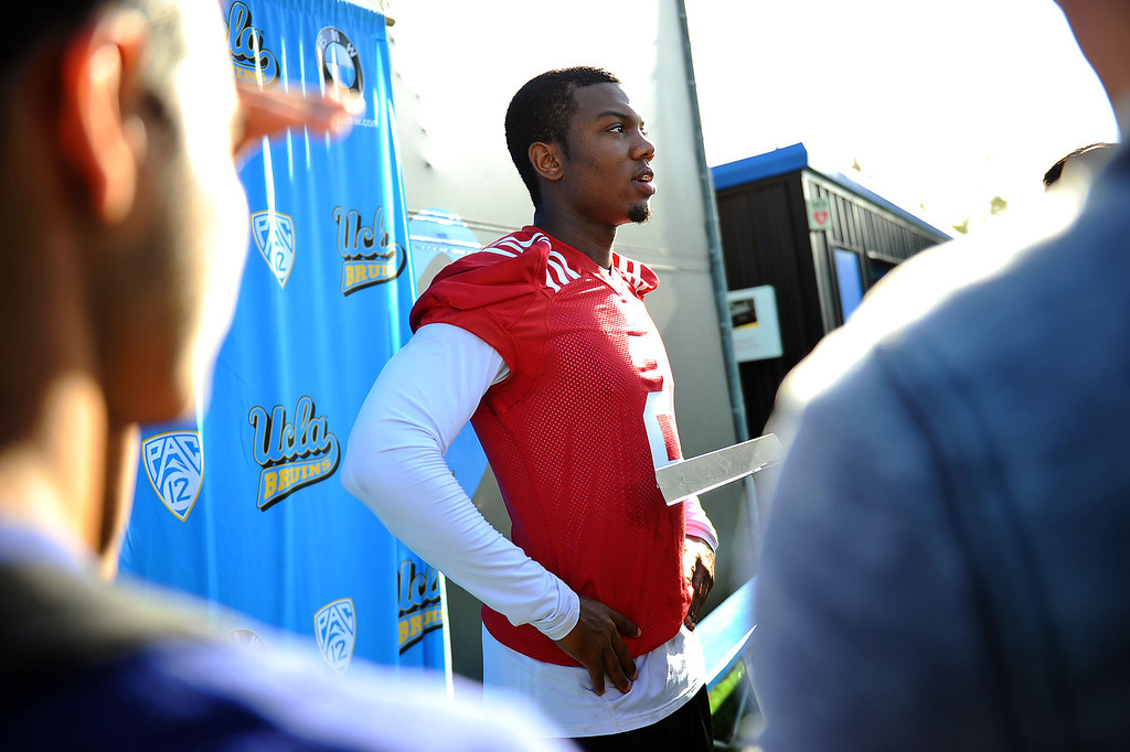 . UCLA Quarterback Asiantii Woulard speaks to members of the media following the final day of spring practice Thursday, April 24, 2014.(Andy Holzman/Los Angeles Daily News)
