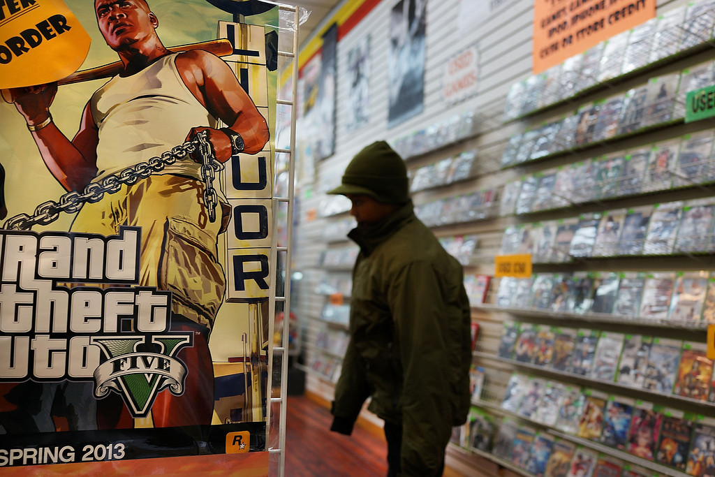. NEW YORK, NY - JANUARY 11: An advertisement for the new Grand Theft Auto is viewed at a gaming store