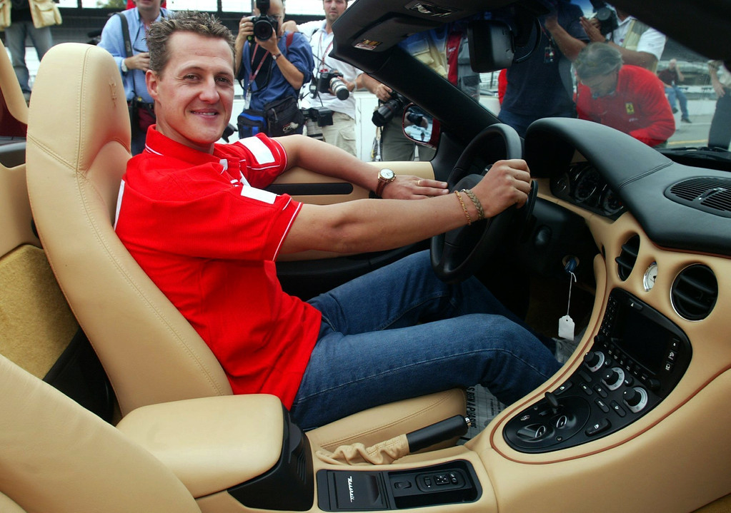 . (dpa) - Michael Schumacher, German formula one champion, smiles as he poses in the cockpit of the new Maserati Spider on the Motor Speedway in Indianapolis, USA, 26 September 2002. Photo by: Gero Breloer/picture-alliance/dpa/AP Images