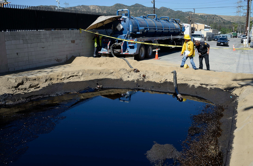. LA City fire investigators take air readings in  Atwater Village on Thursday, May 15, 2014, after a 20-inch above-ground pipeline ruptured, spewing over 10,000 gallons of crude oil onto streets over a half-mile area.  (Photo by Gene Blevins/Los Angeles Daily News)