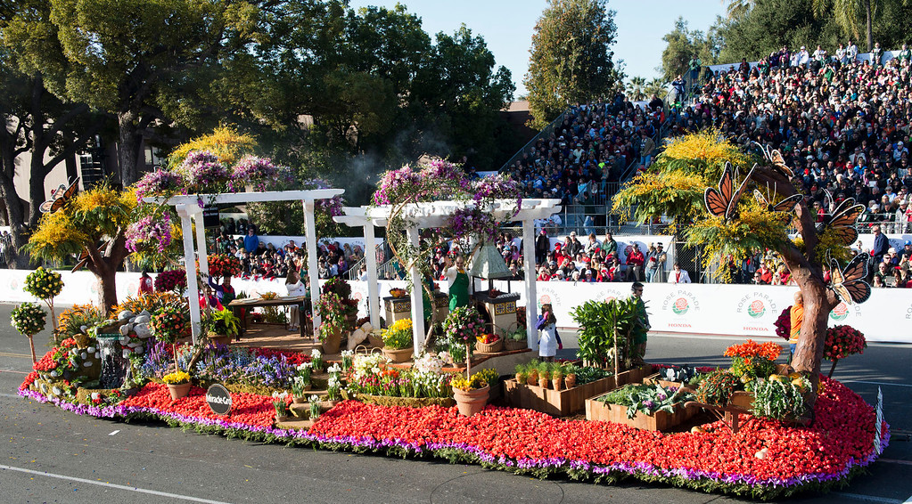 ". Miracle-Gro ""Grow Something Greater\"" float during 2014 Rose Parade in Pasadena, Calif. on January 1, 2014. The float won Quee\'s Award for most effective use and display of roses in concept, design and presentation. (Staff photo by Leo Jarzomb/ Pasadena Star-News)"
