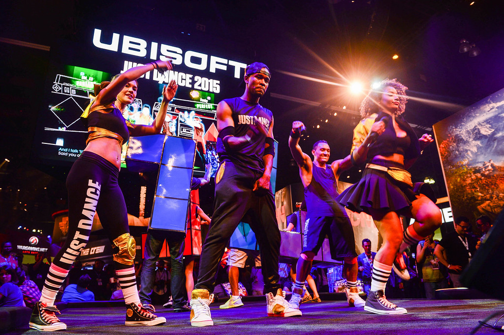 """. Dancers play the \""""Just Dance 2015\"""" at Electronic Entertainment Expo in Los Angeles on Tuesday, June 10, 2014. (Photo by Watchara Phomicinda)"""