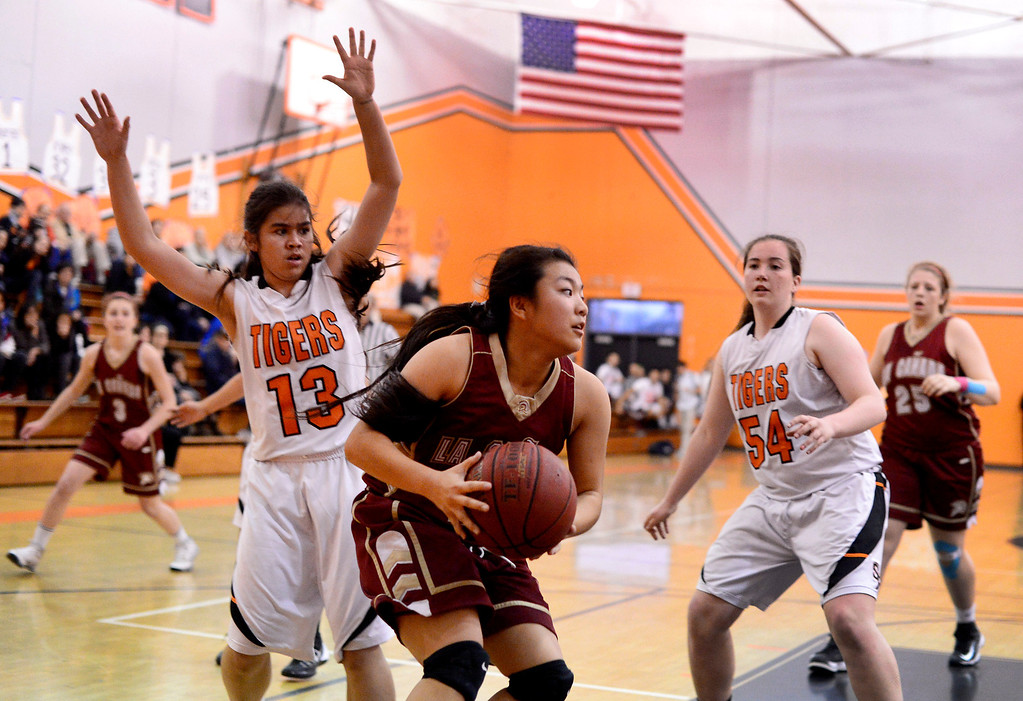 . South Pasadena\'s Lexie Scholtz (13) and Sophia Hathaway (54) approach La Canada\'s Keilee Bessho (15) as South Pasadena defeats La Canada 66-58 Friday night, January 31, 2014 at South Pasadena High School. (Photo by Sarah Reingewirtz/Pasadena Star-News)