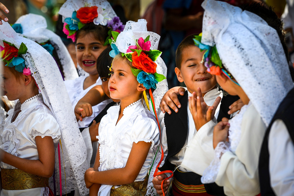 . Children wait to perform at the 41st annual valley Greek Festival at the Saint Nicholas Greek Orthodox Church at the corner of Balboa and Plummer streets in Northridge.  The festival runs through Monday with food, music, dancing and crafts.   ( Photo by David Crane/Los Angeles Daily News )