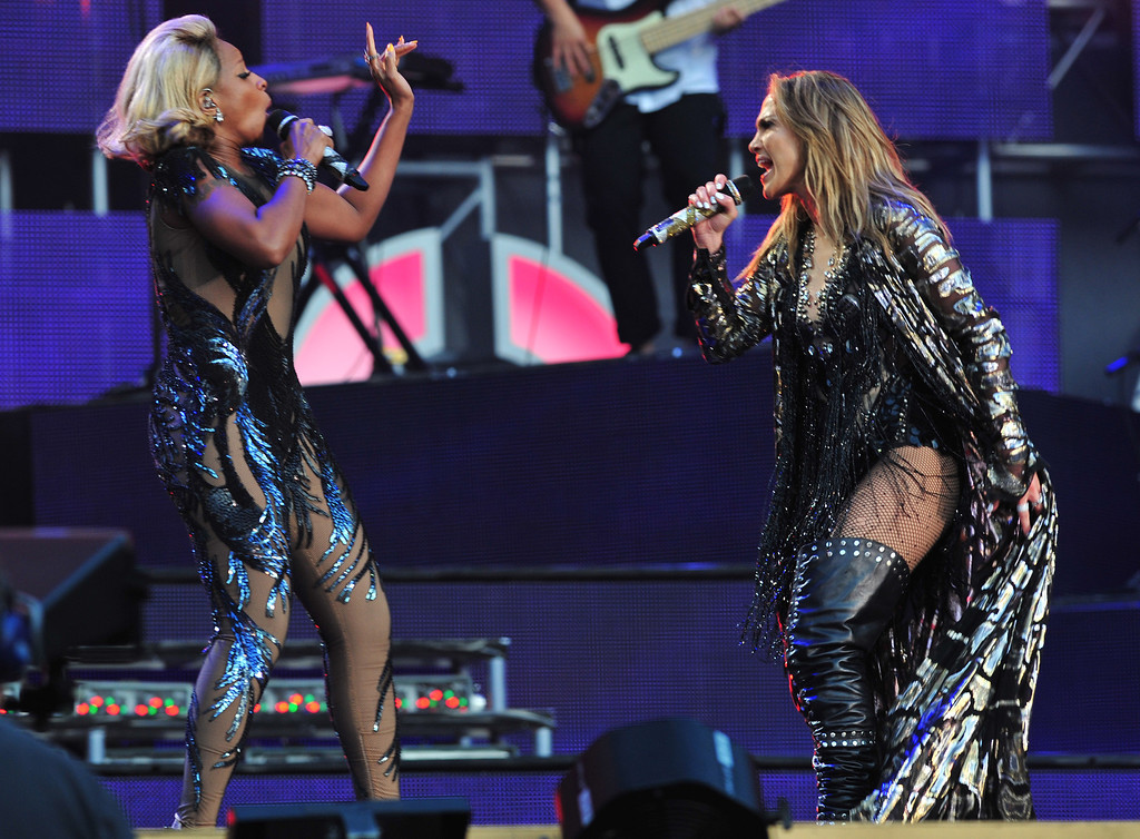 . Mary J. Blige and Jennifer Lopez perform at The Sound of Change Live at Twickenham Stadium in London on Saturday, June 1st, 2013. (Photo by Jon Furniss/Invision/AP Images)