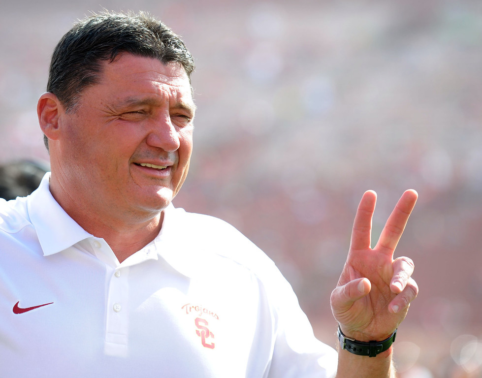 . Southern California head coach Edward Orgeron Jr. poses for a picture prior to an NCAA college football game between Utah and Southern California in the Los Angeles Memorial Coliseum in Los Angeles, on Saturday, Oct. 26, 2013.  (Photo by Keith Birmingham/Pasadena Star-News)