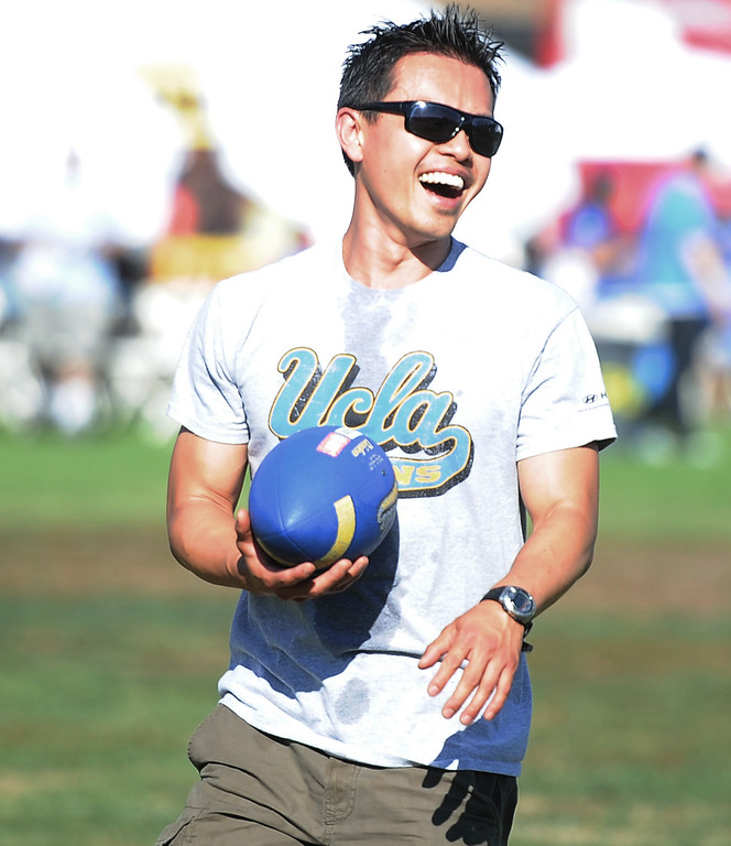 . Brian Yau smiles as he plays catch prior to a college football game between Nevada and UCLA in the Rose Bowl on Saturday, Aug. 31, 2013 in Pasadena, Calif.    (Keith Birmingham Pasadena Star-News)