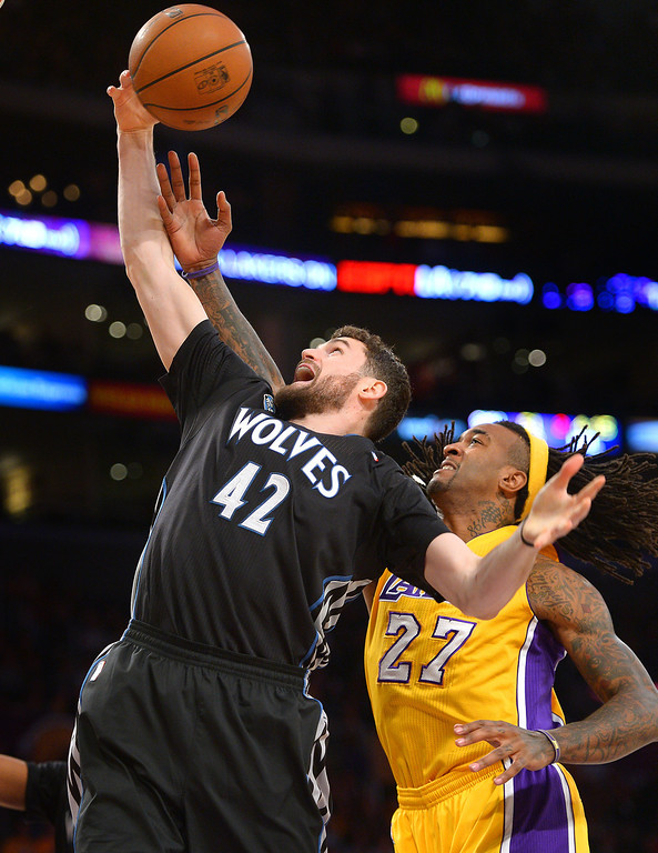 . The Timberwolves\' Kevin Love and the Lakers\' Jordan Hill battle for a rebound in the first half, Friday, December 20, 2013, at Staples Center. (Photo by Michael Owen Baker/L.A. Daily News)