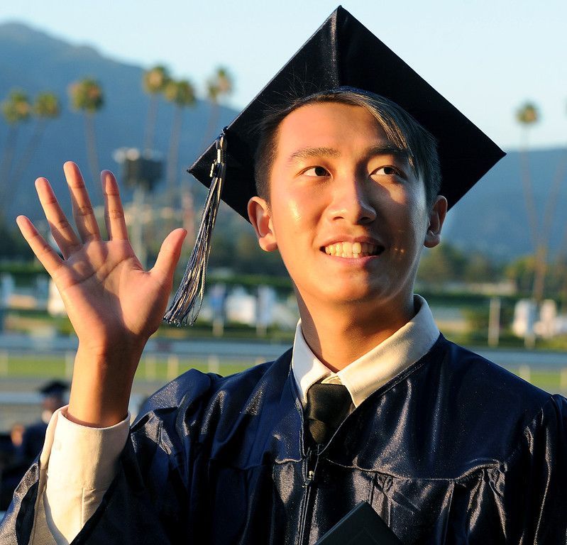 . Zi Ying Liang waves to crowd in stands after receiving his diploma. Gabrielino High in San Gabriel School Class of 2014 graduation was held at Santa Anita Park in Arcadia Wednesday, June 4, 2014.Photo by Walt Mancini/Pasadena Star-News)