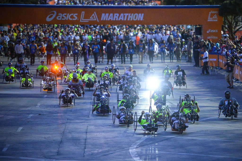 . The wheel chair racers leave Dodger Stadium in darkness with the time change at the start of the 29th Los Angeles Marathon Sunday, March 9, 2014.   (Photo by David Crane/Los Angeles Daily News.)