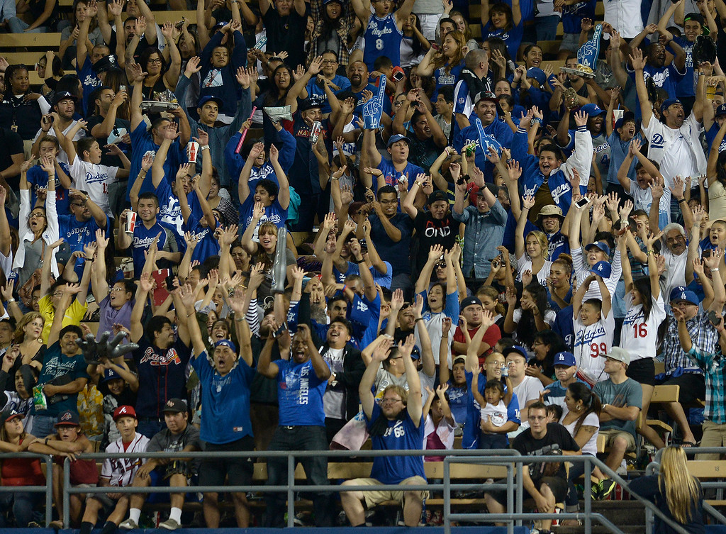 . A restless crowd does the wave in the 7th inning. The Dodgers played host to the Atlanta Braves in a game played at Dodger Stadium in Los Angeles, CA. 7/30/2014(Photo by John McCoy Daily News)