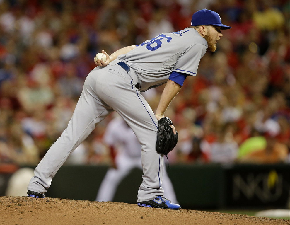 . Los Angeles Dodgers relief pitcher J.P. Howell pitches against the Cincinnati Reds in the fifth inning of a baseball game, Friday, Sept. 6, 2013, in Cincinnati. (AP Photo/Al Behrman)