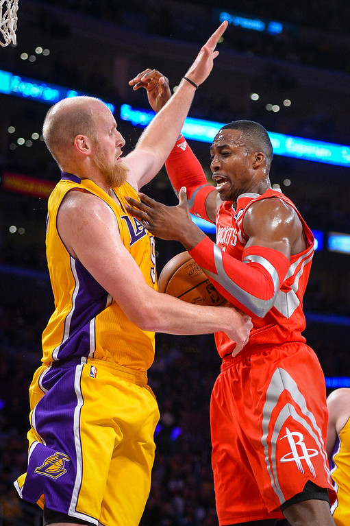 . Lakers� Chris Kaman fouls Rockets� Dwight Howard during first half action at Staples Center Wednesday, February 19, 2014. ( Photo by David Crane/Los Angeles Daily News )